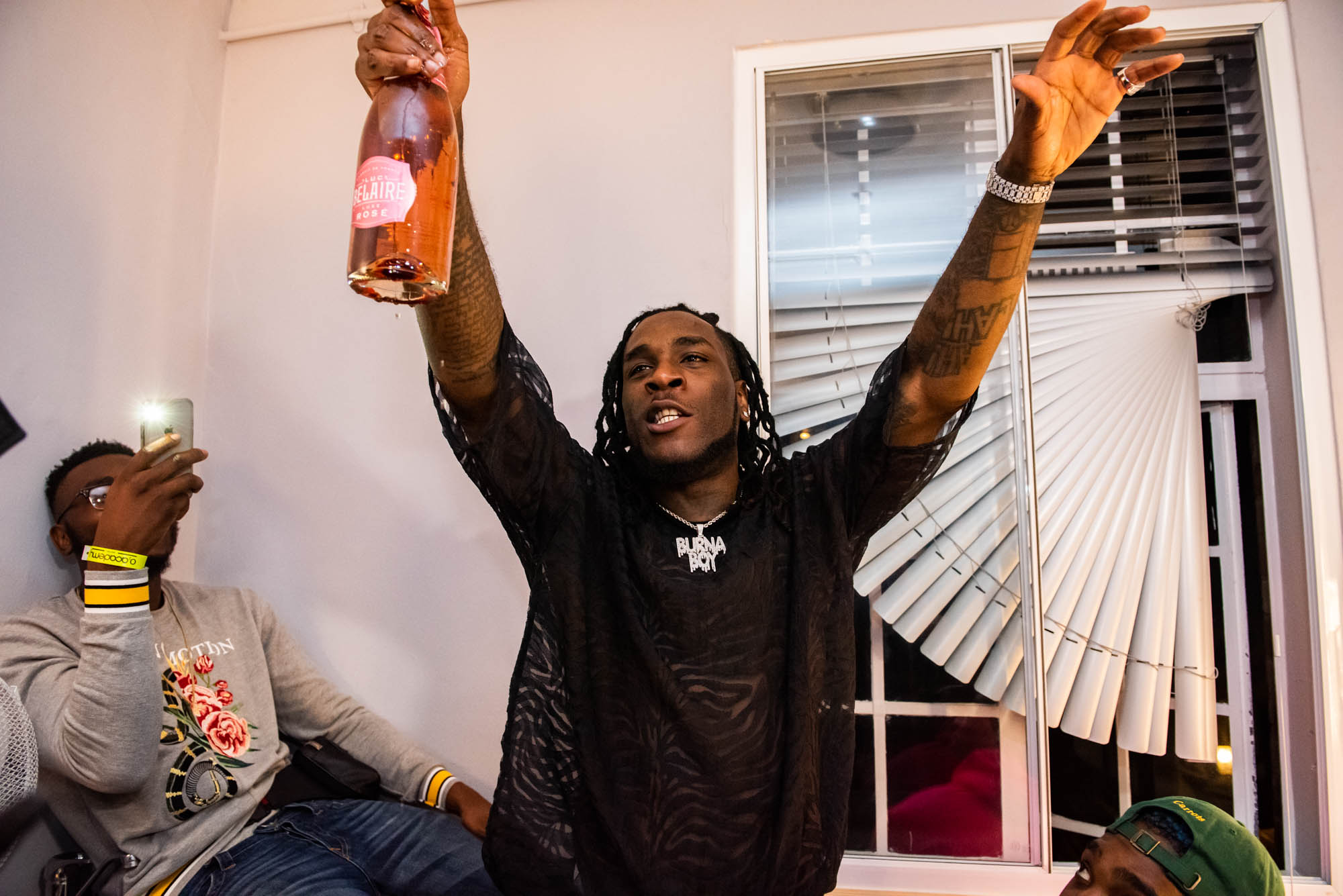 London, United Kingdom. 7th October 2018.  Dressing Room : Burna Boy celebrating his successful concert with Tinie Tempah.  Photographed by Michael Tubes